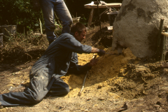 Time Team dig 1998; Jake Keen breaking open the hearth: photo J. Hodgkinson