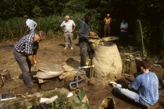 Time Team dig 1998; Dennis Beeney pumping the bellows: photo J. Hodgkinson