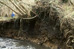 Eroded stream bank section of slag heap: photo J. Hodgkinson