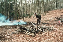 Roger Adams making charcoal in a pit: photo anon