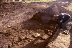 Roffey, excavating the footprint of the ?smithing building: photo J. Hodgkinson