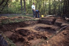 The smelting furnace before excavation with the consolidation hearth behind; Tony Weaver in the background: photo J. Hodgkinson
