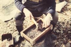 Roger Adams breaking the copper ore: photo anon